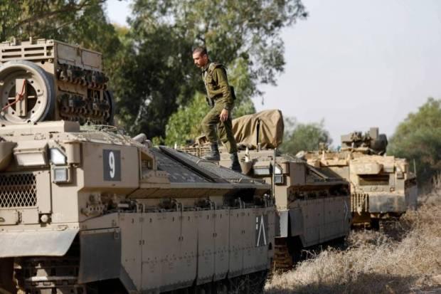 Des soldats israéliens en état d'alerte à la frontière avec Gaza. Menahem Kahana/AFP
